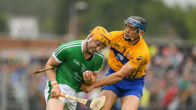 Seamus Flanagan of Limerick in action against David McInerney of Clare