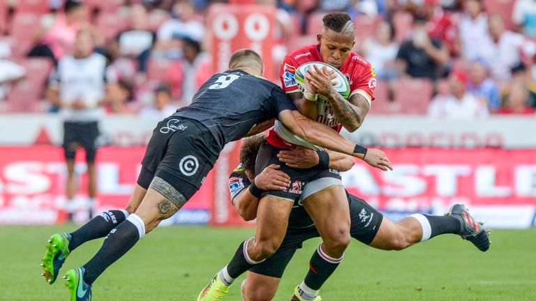 The Lions' Elton Jantjies is shackled by the Sharks' defence during their clash in February