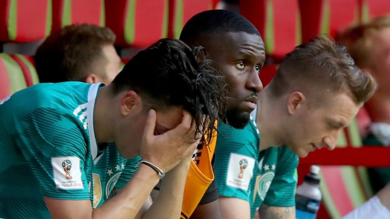 Mesut Ozil, Antonio Rudiger and Marco Reus sit dejected on the Germany bench following their 2-0 loss to South Korea