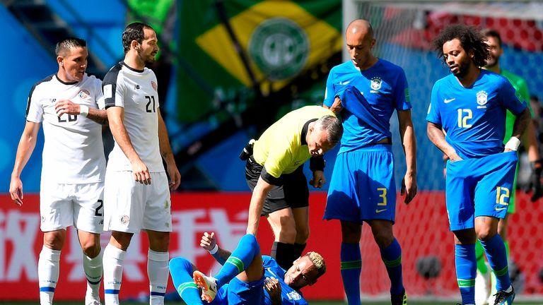 Referee Bjorn Kuipers checks on Brazil's forward Neymar