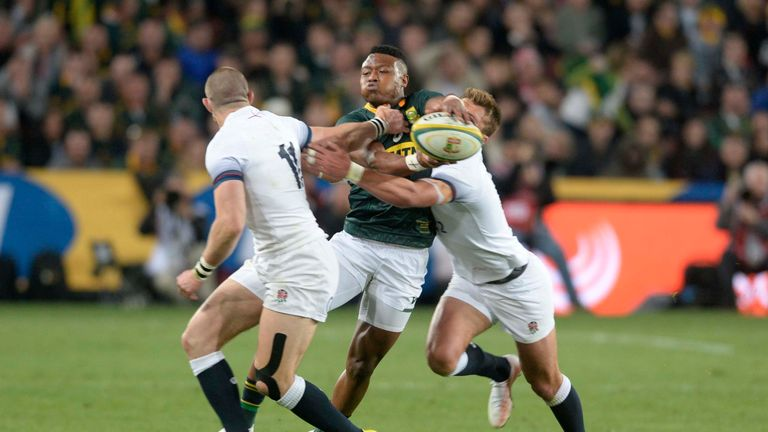 S'busiso Nkosi looks to offload out of the tackle