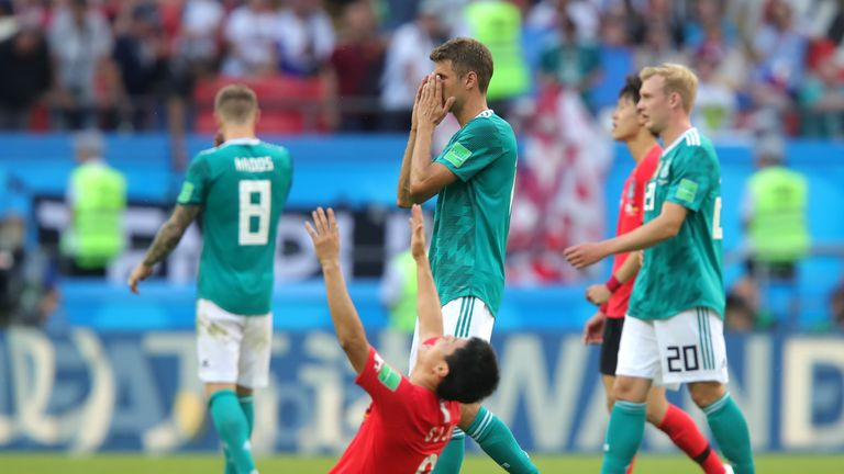 Thomas Mueller reacts to Germany's 2-0 loss to South Korea, resulting in their elimination from the competition