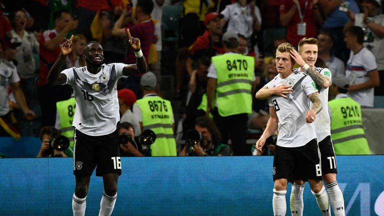 Toni Kroos and Marco Reus spared Germany's World Cup blushes with goals in the second half to seal a 2-1 win over Sweden