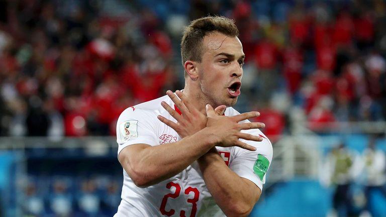 Xherdan Shaqiri celebrates Switzerland's winner against Serbia