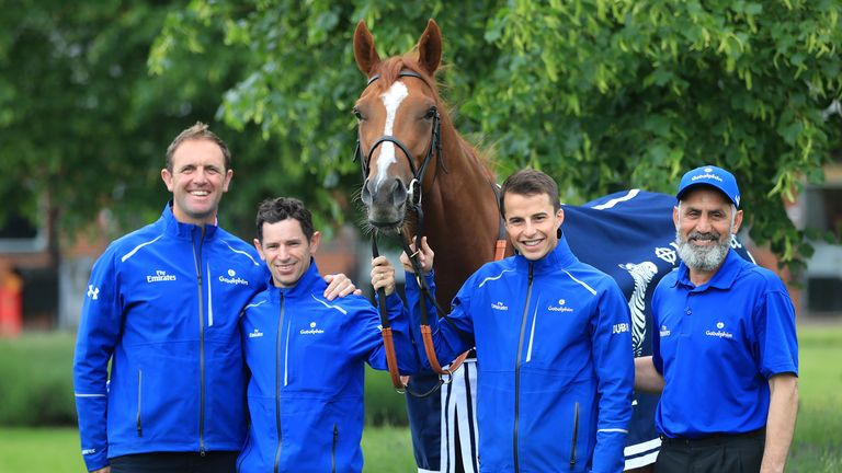 Trainer Charlie Appleby (left), jockey Brett Doyle (centre left), winning jockey William Buick (centre right) and groom Saeed pose with Masar