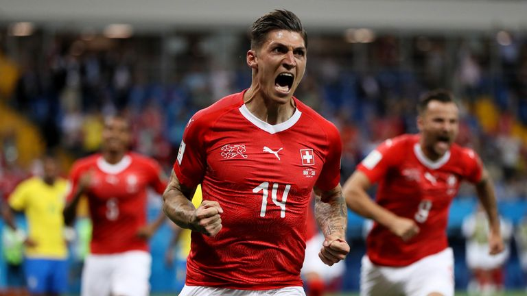 Steven Zuber celebrates after equalising for Switzerland