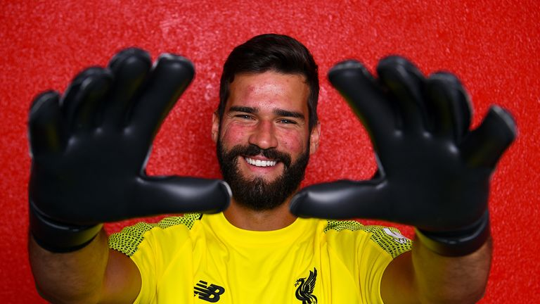 Alisson poses for photographs at Melwood after signing for Liverpool on July 19, 2018