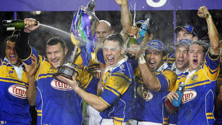 Barrie McDermott covers Kevin Sinfield in champagne following Leeds' win over the Canterbury Bulldogs in the 2005 World Club Challenge.