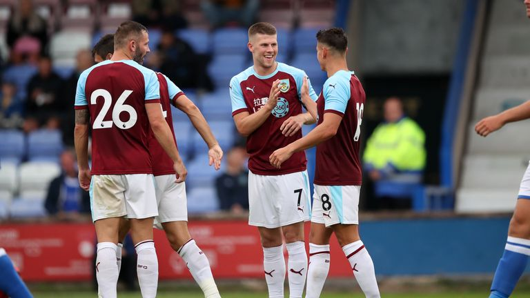 Johann Berg Gudmundsson (centre) celebrates his goal against Macclesfield