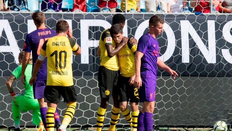 Borussia Dortmund's Christian Pulisic (2nd R) celebrates scoring a goal from a free kick