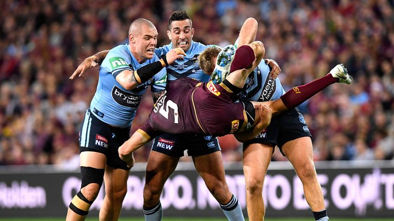 Corey Oates of Queensland is picked up in the tackle by Jake Trbojevic of the Blues
