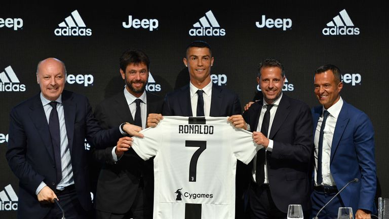 Cristiano Ronaldo holds up his new shirt as his Juventus unveiling