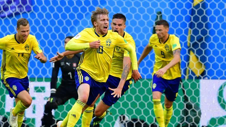 Emil Forsberg wheels away in celebration after giving Sweden the lead