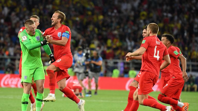 England's players celebrating after their penalty shootout victory