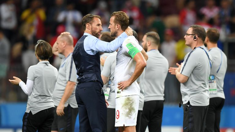 Kane (right) and Gareth Southgate commiserate after England's loss to Croatia