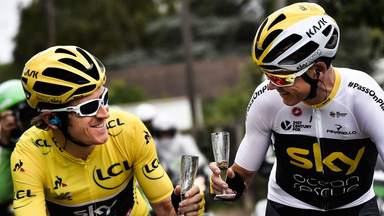 Geraint Thomas and Froome (right) share a glass of champagne on the ride into Paris