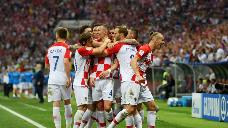 Goalscorer Ivan Perisic celebrates with team-mates after equalising for Croatia