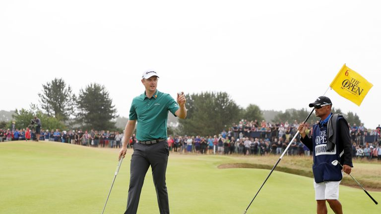 Justin Rose birdied the 18th to make the cut on Friday