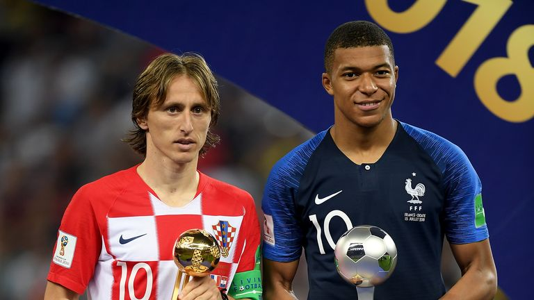 Luka Modric and Kylian Mbappe receive individual awards following the World Cup final