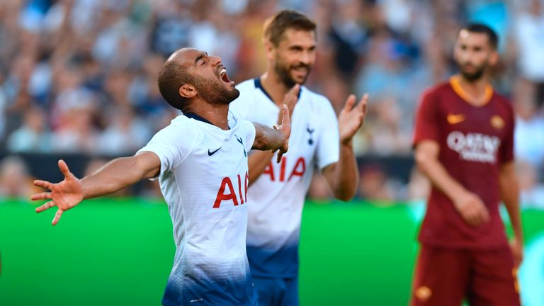 Lucas Moura (L) netted a double against Roma
