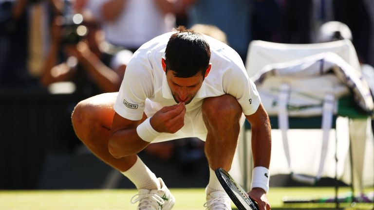 """Djokovic enjoyed a """"double portion"""" of Centre Court grass, his now-traditional post-match treat"""