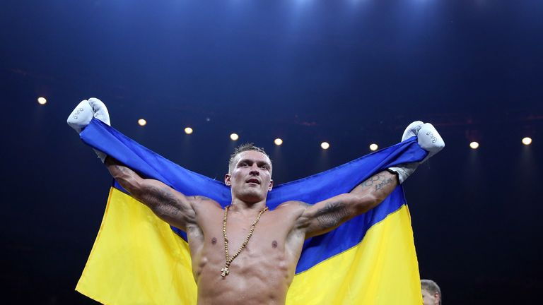 BERLIN, GERMANY - SEPTEMBER 09: Aleksandr Usyk of Ukraine celebrates after winning the WBO Cruiserweight World Boxing Super Series fight against Marco Huck of Germany at Max Schmeling Halle on September 9, 2017 in Berlin, Germany. (Photo by Ronny Hartmann/Bongarts/Getty Images)   *** Local caption *** Aleksandr Usyk