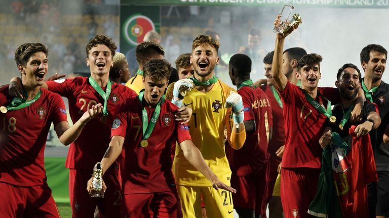 Portugal players, including Joao Filipe (C), celebrate winning the tournament