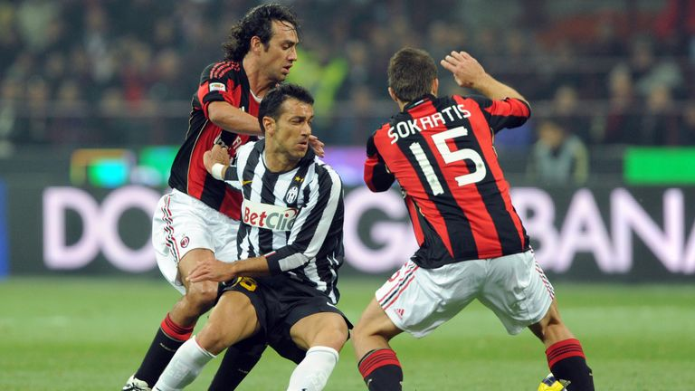 Papastathopoulos and Alessandro Nesta in action for Milan in 2010