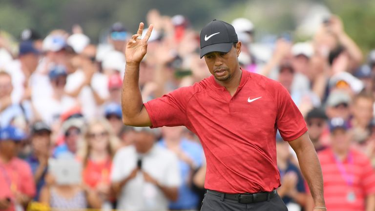 Tiger Woods held the outright lead at the turn before running into trouble at the 11th