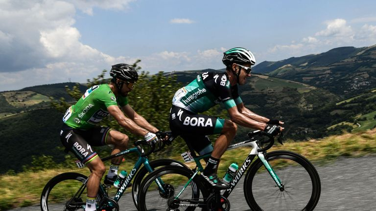 Slovakia's Peter Sagan (L), wearing the best sprinter's green jersey, and Poland's Pawel Poljanski ride during the 15th stage