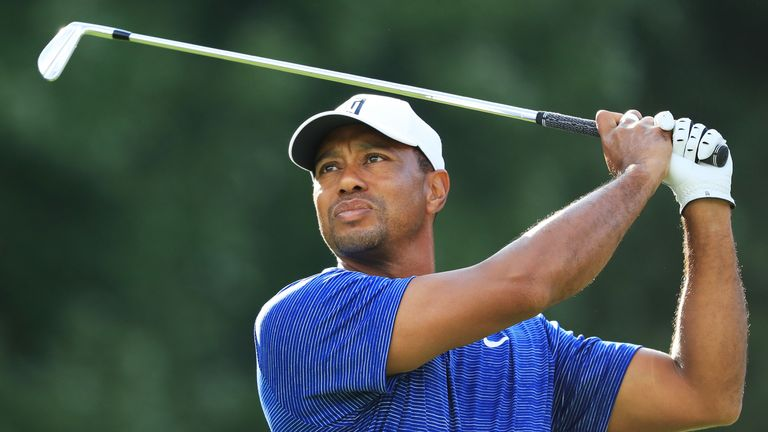 tiger woods sits five shots off the lead after the opening round