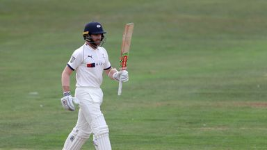 Kane Williamson celebrates reaching a fifty against Worcestershire, at Scarborough