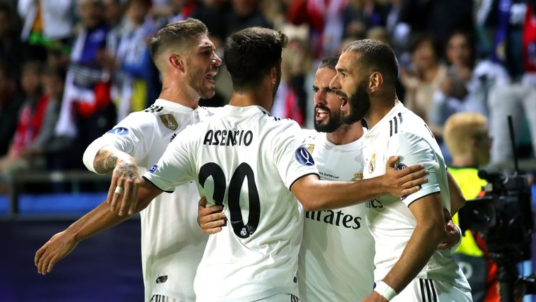 Karim Benzema is congratulated by team-mates after scoring Real Madrid's equaliser