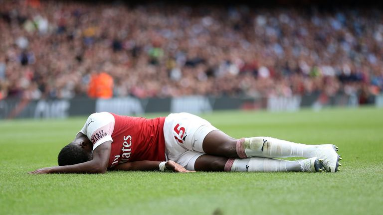Ainsley Maitland-Niles lies injured at the Emirates Stadium during Sunday's Premier League match against Manchester City
