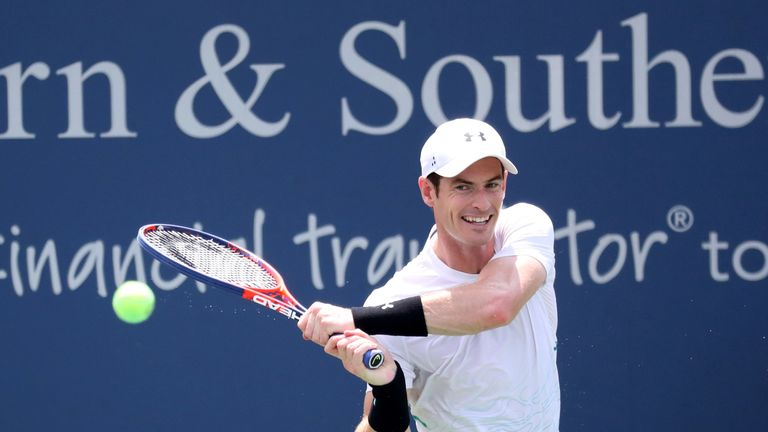 Andy Murray of Great Britain returns a shot to Lucas Pouille of France during Day 3 of the Western and Southern Open at the Lindner Family Tennis Center on August 13, 2018 in Mason, Ohio