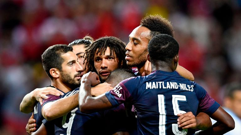 Pierre-Emerick Aubameyang celebrates with team-mates after scoring for Arsenal against Lazio