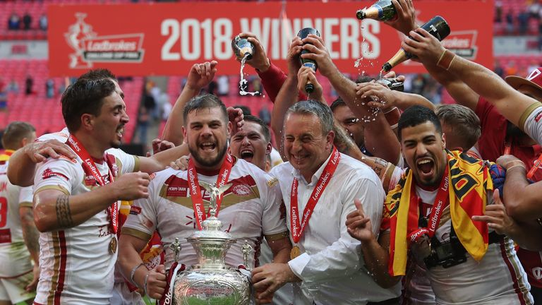 Tony Gigot, Remi Casty and head coach Steve McNamara celebrate winning the Challenge Cup