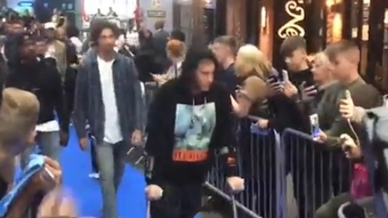 Kevin De Bruyne attended a film premiere in Manchester on crutches after suffering a knee injury in training.