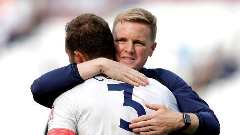 Eddie Howe embraces Steve Cook, whose header proved to be the winner at the London Stadium