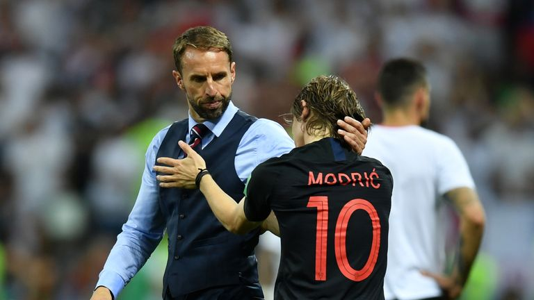 Gareth Southgate embraces Luka Modric after England's World Cup exit