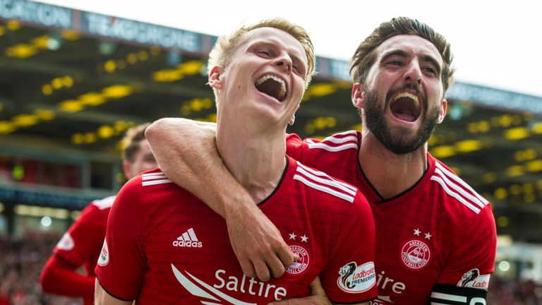 Aberdeen's Gary Mackay-Steven (L) celebrates his second goal with Graeme Shinnie.