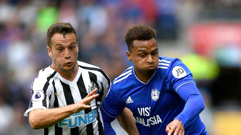 Javier Manquillo battles for possession with Josh Murphy