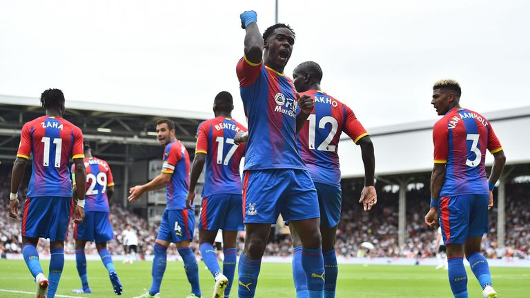 Jeffrey Schlupp pumps his fist in celebration after giving Crystal Palace a 1-0 lead