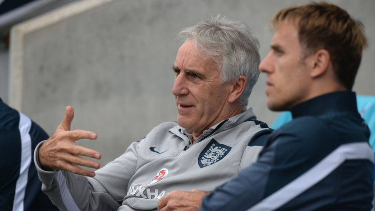 John Peacock discussing the game with England women's coach Phil Neville