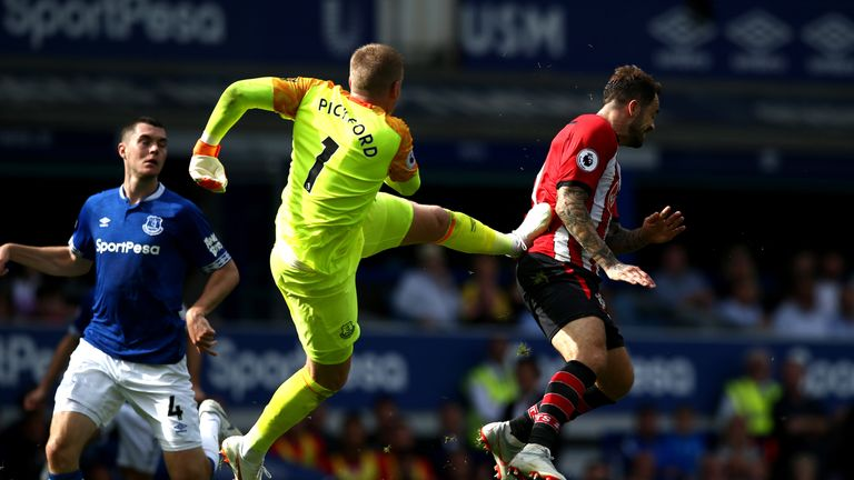 Mark Hughes feels Jordan Pickford should have been sent off for this challenge on Danny Ings