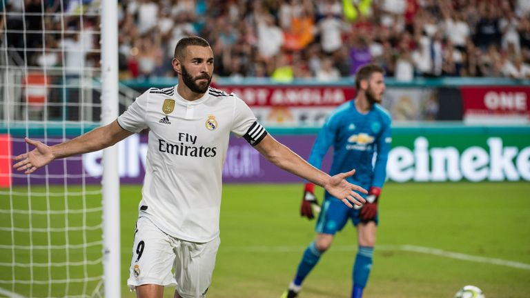 Karim Benzema wheels away after scoring against Manchester United