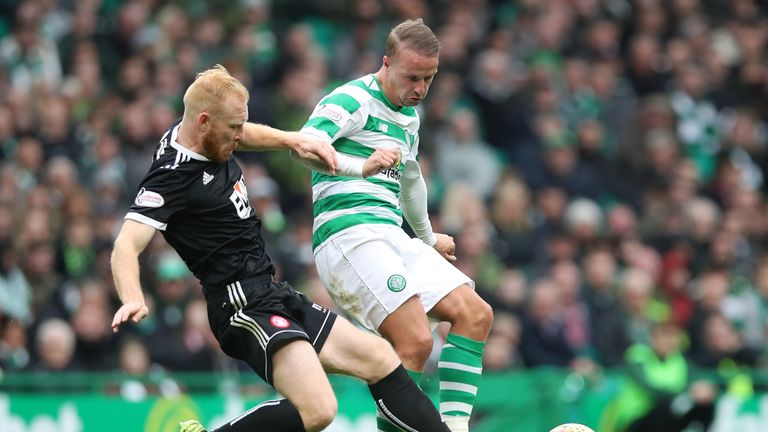 Leigh Griffiths (R) battles for the ball with Ziggy Gordon