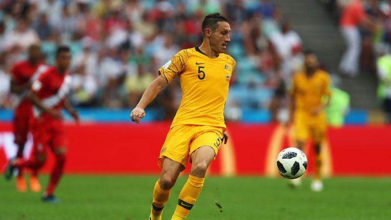 Midfielder Mark Milligan has joined Hibernian on a two-year deal