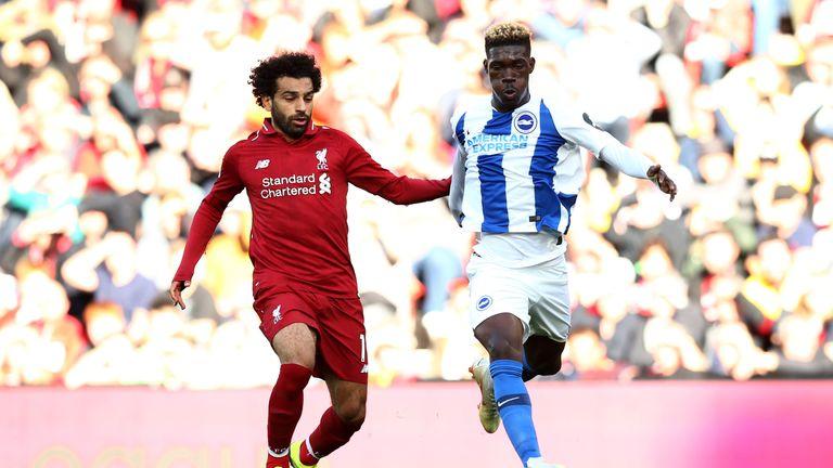 Bissouma battles for possession with Liverpool's Mohamed Salah