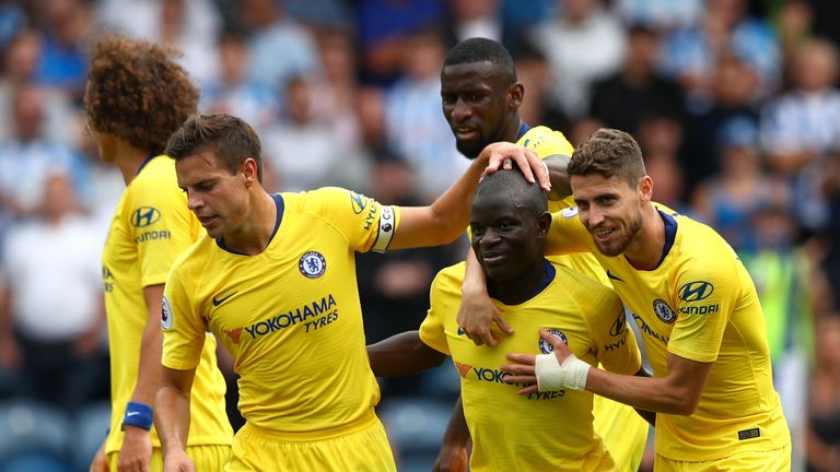 Kante is congratulated by Jorginho after scoring Chelsea's first goal against Huddersfield